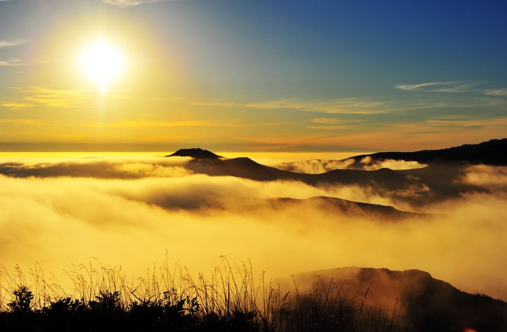 Sunlight illuminates fog over Marin County