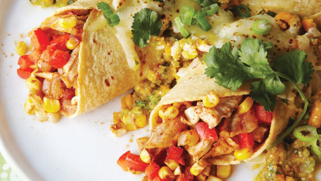 Plated Chicken Enchiladas with Corn & Cape Gooseberry Salsa - Clean Eating Magazine