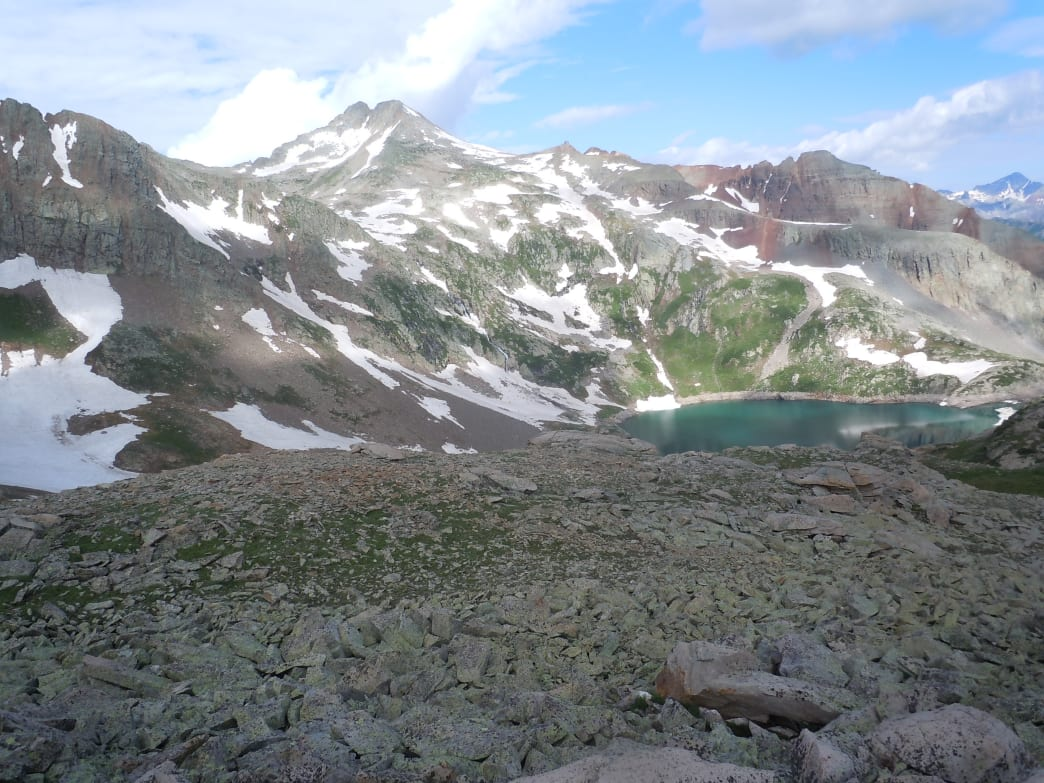 Rock sediments are carried through snow melt to mountain lakes, contributing to the jade-colored waters of Lake Hope.