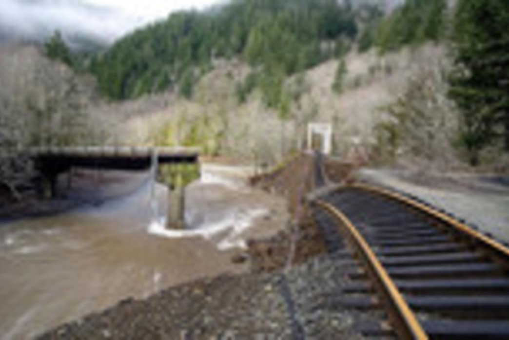 Hikers follow a set of derelict train tracks throughout the Salmonberry River trail hike.