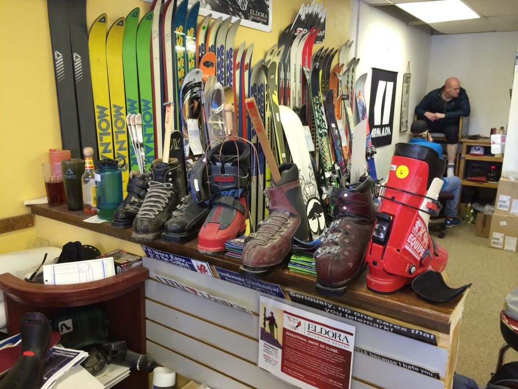 Customers have donated dozens of vintage boots and skis to Larry's Bootfitting