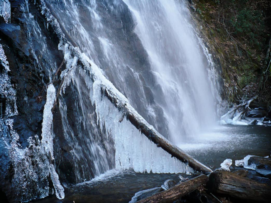 Icicle collects in a curtain beneath Crabtree Falls, one of Asheville's waterfalls.