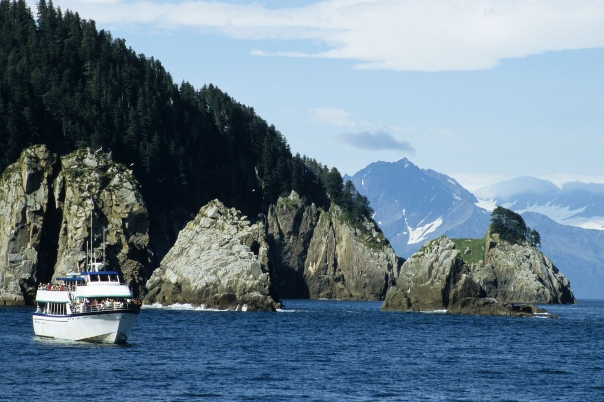 A cruise ship sailing through the sea near Kenai Fjords, one of the most visited Alaska national parks